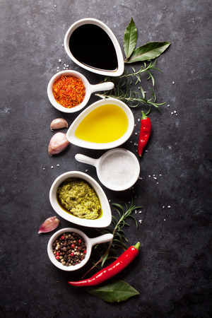 condiments: Herbs, condiments and spices on stone background. Top view