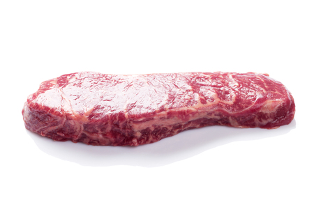 raw beef: Raw striploin steak. Isolated on white background