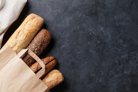 Mixed breads on stone table. Top view with copy space Standard-Bild