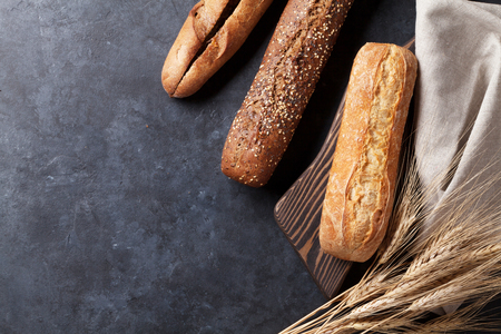 Mixed breads on stone table. Top view with copy space Stock Photo