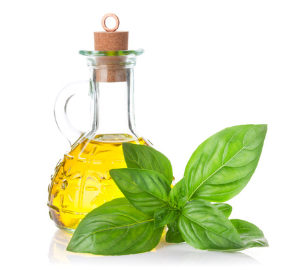 spicy plant: Fresh garden basil and olive oil. Isolated on white background Stock Photo
