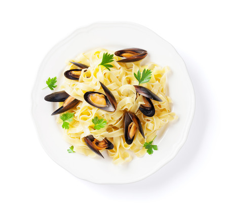 Pasta with seafood. Mussels. Isolated on white background. Top view