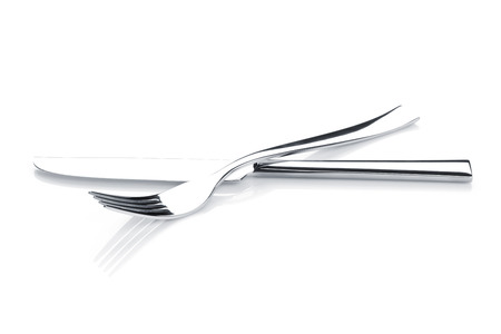 flatware: Silverware or flatware set of fork and knife. Isolated on white background