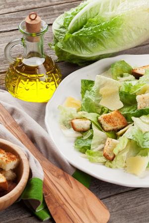 caesar salad: Fresh healthy caesar salad on wooden table