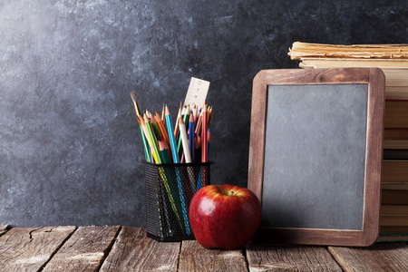 Books, supplies and chalk board for your text. Back to school concept with copy space Stock Photo
