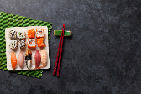 table set: Set of sushi and maki roll on stone table. Top view with copy space