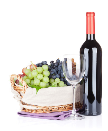 glass background: Red wine bottle, glass and grapes. Isolated on white background Stock Photo