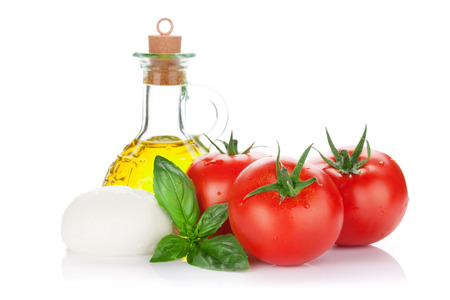 white cheese: Mozzarella cheese, olive oil, tomato and basil herb leaves. Isolated on white background