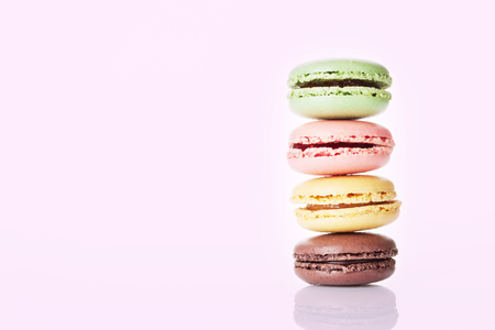 sweet background: Sweet macarons over color background with copy space
