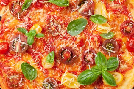 closeup view: Homemade pizza with tomatoes, mozzarella and basil. Closeup. Top view Stock Photo