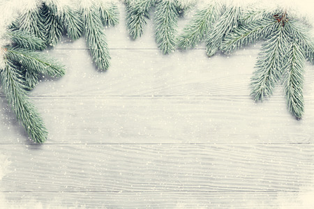 wooden boards: Christmas wooden background with fir tree. View with copy space. Toned