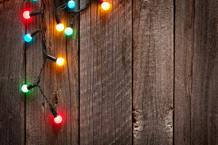 madera rústica: Christmas colorful lights on wooden table with copy space Foto de archivo