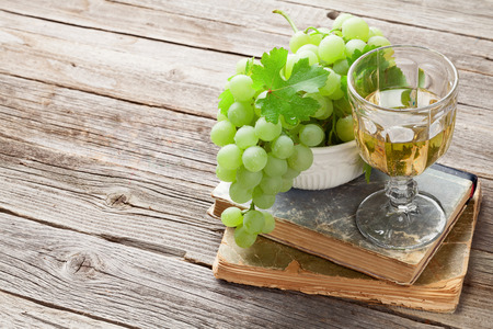 white grape: White grape and glass of wine on wooden table. View with copy space for text