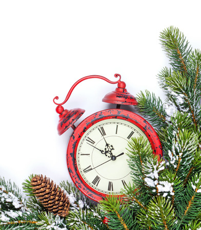 Christmas background with alarm clock, snow fir tree. Isolated on white background