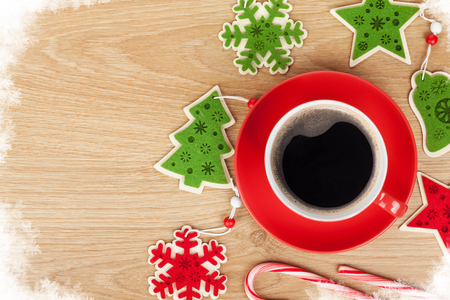 top of the year: Coffee cup and christmas decor on wooden background with copy space