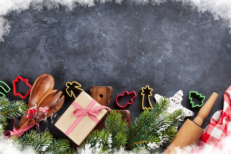 chalk board: Christmas cooking utensils and snow tree on stone table. Top view with copy space