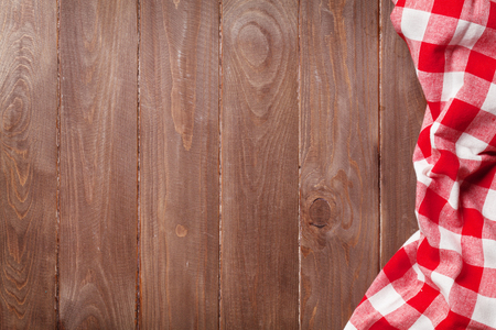 red cloth: Towel over wooden kitchen cooking table. Top view with copy space