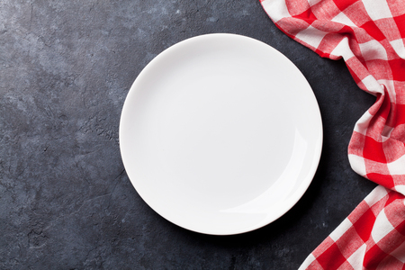 Empty plate and kitchen towel over stone table. Top view with copy space for your recipe Stock Photo - 64363630