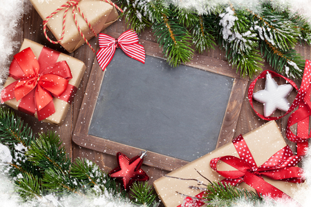 christmas decor: Christmas chalkboard, gift boxes, decor and fir tree. Top view with copy space for your text