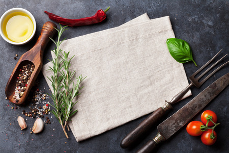 kitchen table top: Herbs and spices. Top view over stone table with copy space for your recipe