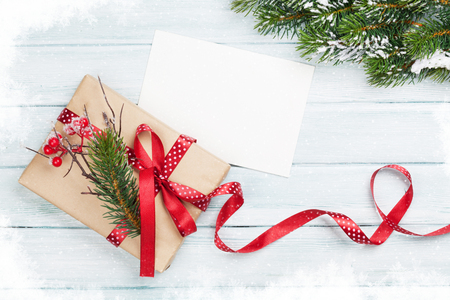 christmas gift box: Christmas gift box and greeting card on wooden background. Top view with copy space