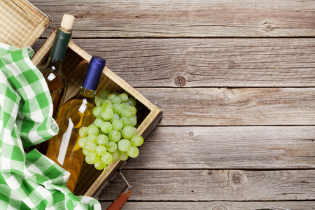 wine grape: White wine and grapes on wooden table. Top view with copy space for your text