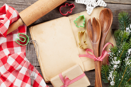 christmas cooking: Cook book and utensils on wooden table. Christmas cooking. Top view with copy space Stock Photo