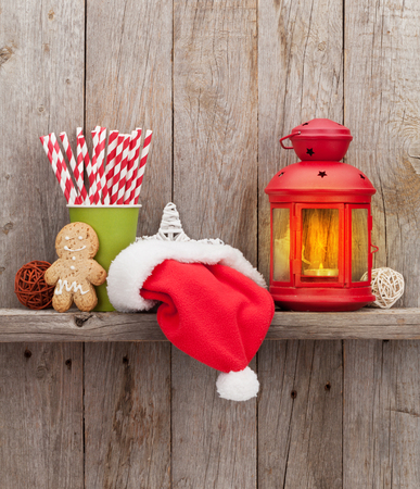 wall decor: Christmas candle lantern and decor in front of wooden wall