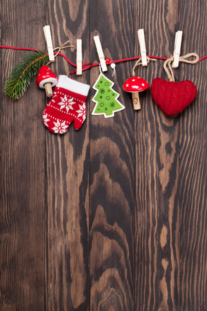 Christmas decor on rope over wooden background with copyspace Stock Photo