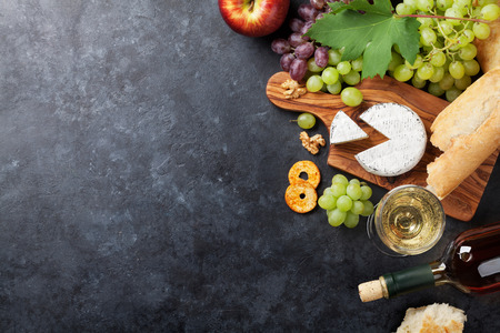 wine grape: White wine, grape, bread and cheese on stone table. Top view with copy space Stock Photo