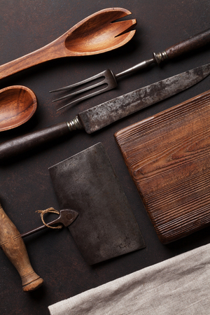 grunge silverware: Old vintage kitchen utensils. Fork, knife, cutting board. Top view Stock Photo