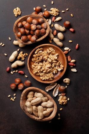 Various nuts on stone table. Top view 版權商用圖片