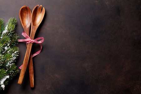 Christmas background with kitchen utensils. Xmas cooking concept. Top view with copy space for recipe