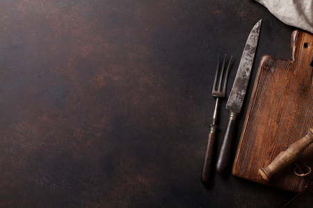 grunge silverware: Old vintage kitchen utensils on stone table. Top view with copy space Stock Photo