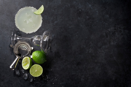 Margarita cocktail on dark stone table. Top view with space for your text Stock fotó - 68747595