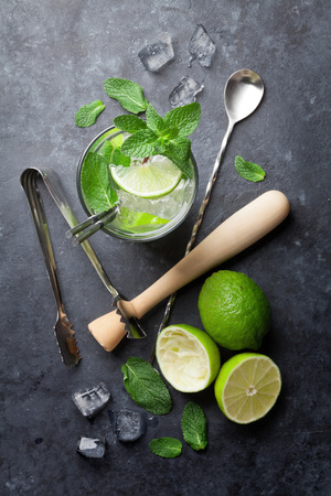 Mojito cocktail on dark stone table. Top view Stock Photo