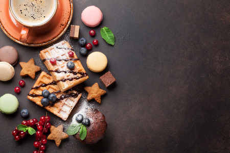 coffee and cake: Coffee with waffles and sweets. Top view with copy space for your text