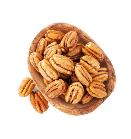 pecans: Pecan nuts in bowl. Isolated on white background Stock Photo