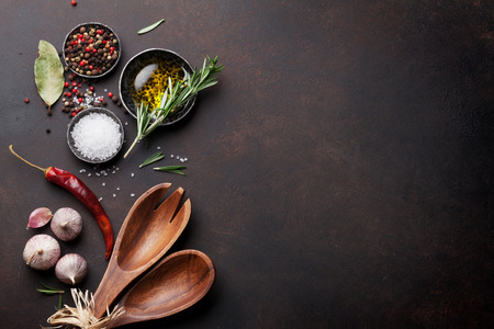 Cooking table with herbs, spices and utensils. Top view with copy space Reklamní fotografie - 69598658