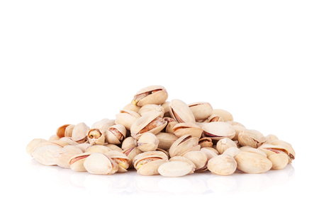 pistachios: Pistachios nuts. Isolated on white background Stock Photo