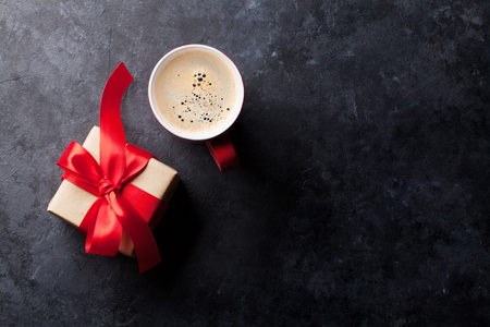 Valentines day greeting card. Red coffee cup and gift box on stone table. Top view with copy space Stok Fotoğraf - 70473670