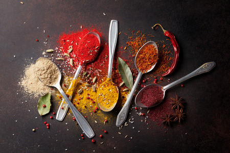 Various spices spoons on stone table. Top view Stock Photo