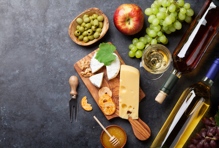 White wine, grape, bread and cheese on stone table. Top view with copy space Stock Photo - 71675987