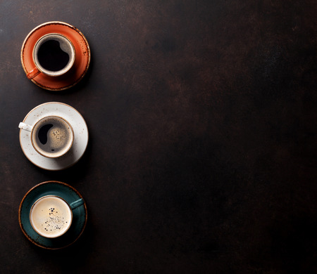 cafe menu: Coffee cups on old kitchen table. Top view with copyspace for your text