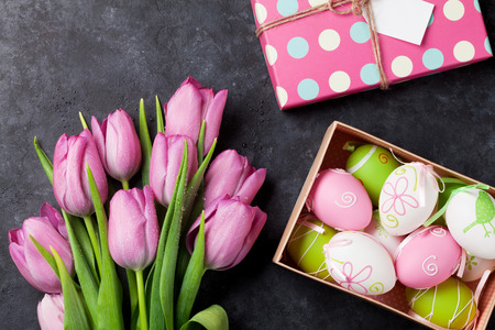 Fresh pink tulip flowers and easter eggs in gift box on stone fresh pink tulip flowers and easter eggs in gift box on stone table top view negle Image collections