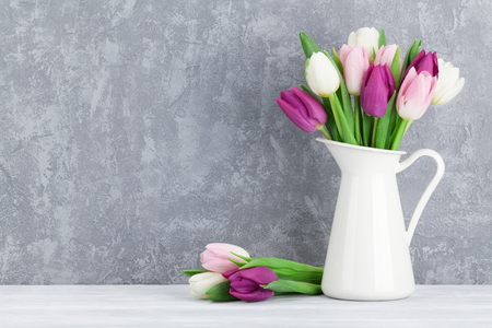 blue tulip: Colorful tulips bouquet in front of stone wall with space for your greetings
