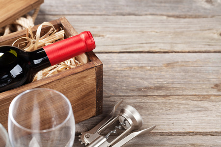 Red wine bottle and glasses on wooden table. View with copy space Stock Photo