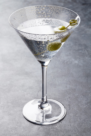 Martini cocktail on dark stone table Stock Photo