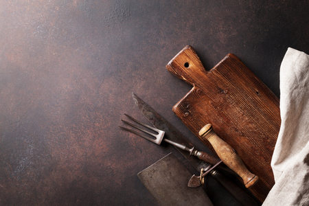 Old vintage kitchen utensils. Fork, knife, spoons, cutting board. Top view with copy space Stock Photo