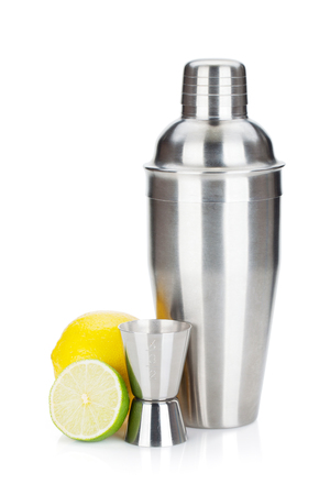 Cocktail shaker with maeasuring cup and citruses. Isolated on white background Imagens